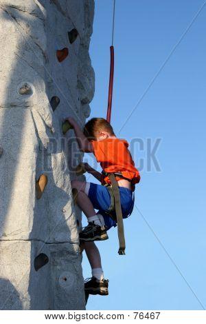 Boy Wall Climbing Outdoors