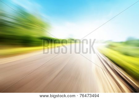 Empty country road in motion blur and sunlight.  poster
