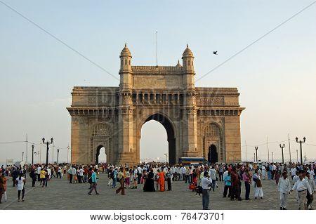 Pedestrians enjoying the evening at the Gateway to India Mumbai