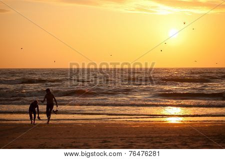 Sunset in Baltic sea with silhouettes of two girls Palanga Lithuania poster