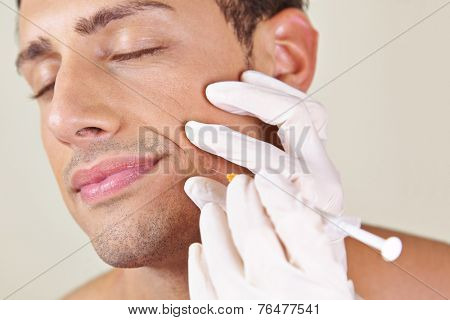 Man in a beauty clinic getting wrinkle treatment near his mouth