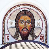 Mosaic classical icon of Jesus Christ in byzantine style on the white orthodox church wall, square image poster