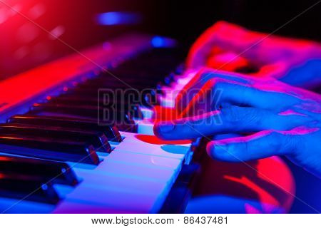 Hands Of Musician Playing Keyboard In Concert With Shallow Depth Of Field
