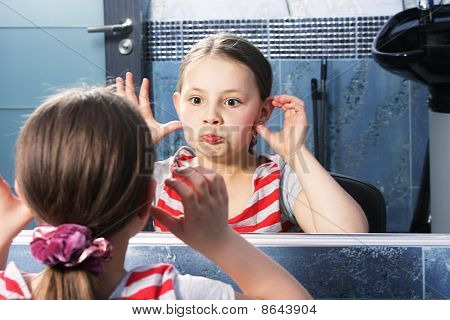 Girl Grimacing At Mirror