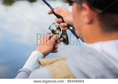Fishing in river.