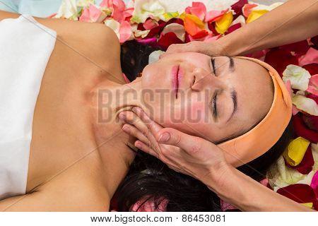 Beauty treatments in the beauty salon. Beautician revitalizing facial. Facial massage. Beauty, facial, beautician. poster
