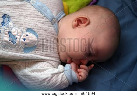 baby sucking her finger
