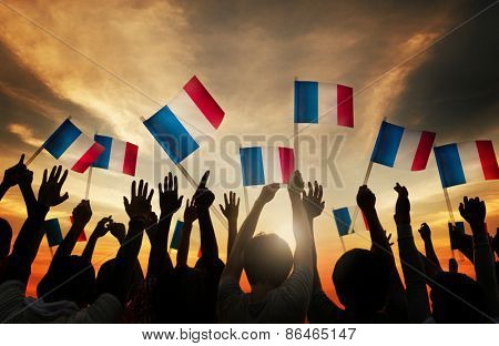 Group of People Waving French Flags in Back Lit