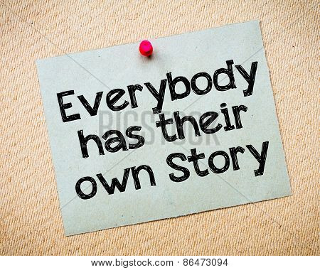 Everybody has their own story Message. Recycled paper note pinned on cork board. Concept Image poster