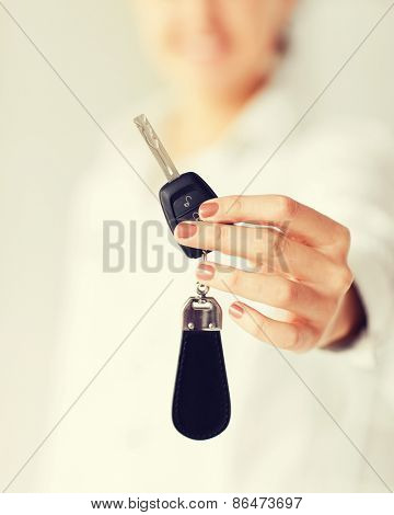 business, banking, vehicle, rental, automotive concept - woman hand holding car key