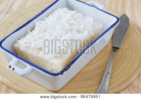 Sweet Couscous (tapioca) Pudding (cuscuz Doce) With Coconut On Wooden Table