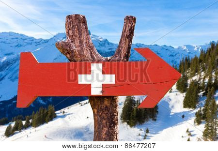 Switzerland wooden sign with alps background