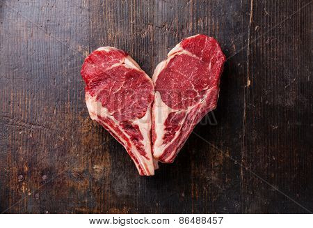 Heart Shape Raw Meat Ribeye Steak Entrecote On Wooden Background