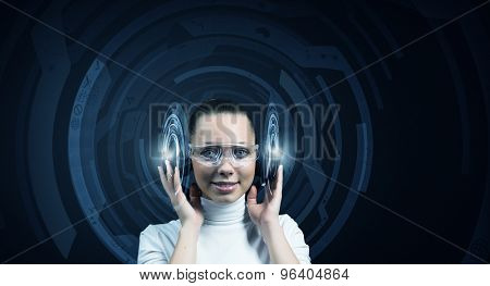 Young woman wearing headphones on digital blue background poster