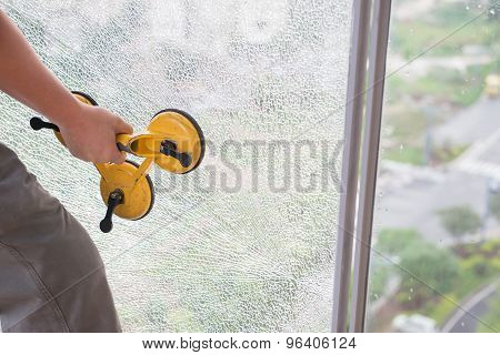 Taking Out On A Broken Window With Suction Plate