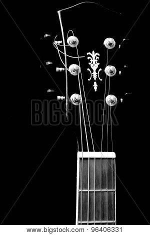 Headstock of Acoustic guitar isolated on black background