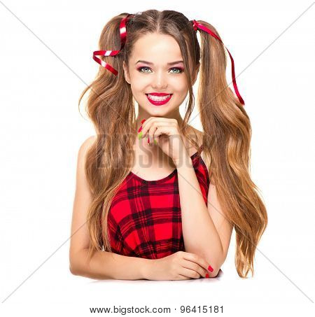 Beauty surprised fashion model girl Smiling. Funny pigtails hairstyle, red and green nail art and bright makeup isolated on white background. Positive emotions, smile. Beautiful young woman portrait