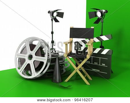 Video, Movie, Cinema Concept. Light, Film Strip, Reels, Clapperboard And Director Chair On The Green