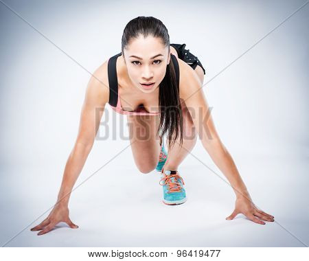 Race Start Position With Gorgeous Girl In Fitness Postion