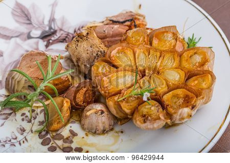 Garlic Head With Herbs Roasted In Fat