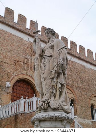 A sculpture of a woman with a sword