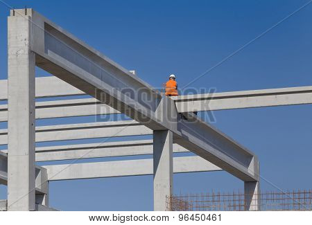 Construction worker sitting on concrete beam on height and waiting crane to lift truss for installation poster
