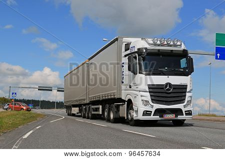 White Mercedes-Benz Actros Truck Trailer In Traffic