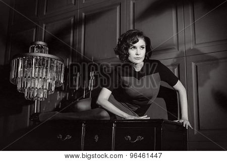 Young woman in horror movie at black and white poster