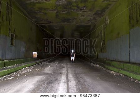 Hiker In Abandoned Tunnel