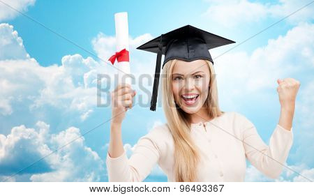 education, high school, knowledge, graduation and people concept - happy student girl or woman in trencher cap with diploma certificate over blue sky and clouds background