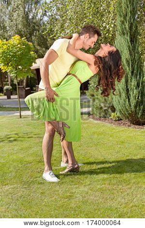 Full length of romantic young couple dancing in park