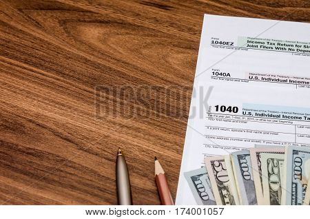Unite States 1040 tax form with money on desk