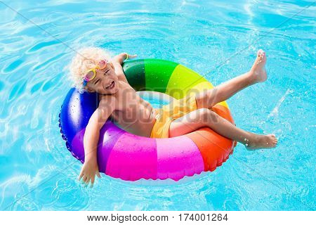Child With Toy Ring In Swimming Pool