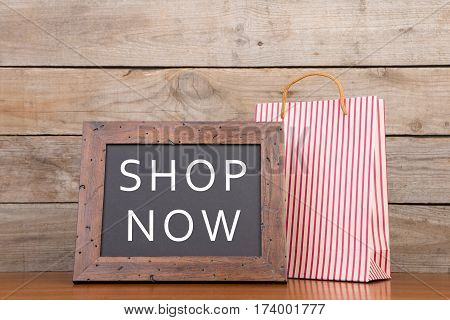 Shopping Bag And Blackboard With Text