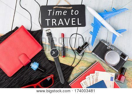 Blank Blackboard, Plane, Map, Passport, Money, Watch, Camera, Notepad, Sunglasses, Wallet On White W