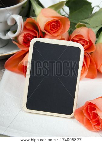 wooden plaque and a bouquet of roses