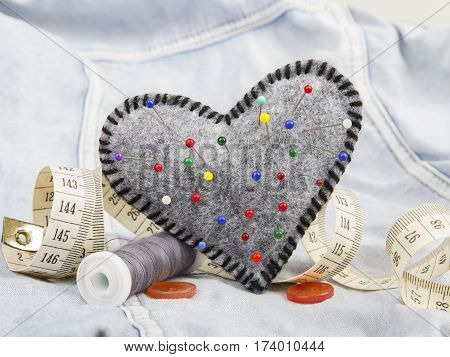 Heart shaped pincushion and tailor accessories, copy space