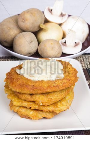 tatsy golden potato pancakes with mushroom sauce