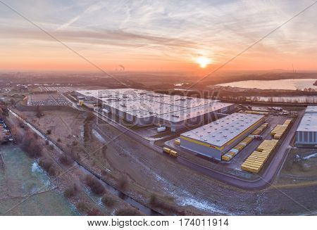 RHEINBERG GERMANY - JANUARY 29 2017 : The Amazon distribution centre with connection to DHL and HAVI enjoying the sunrise