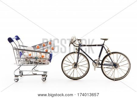 Shopping Cart With Pills And A Bicycle