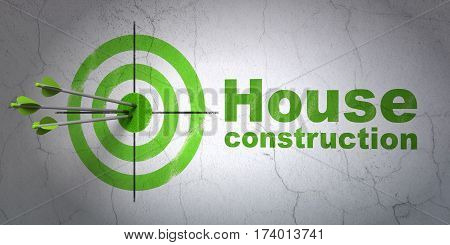 Success building construction concept: arrows hitting the center of target, Green House Construction on wall background, 3D rendering