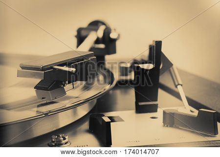 vintage music player turntable with lp in bw