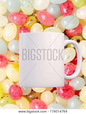 Easter Mug Mockup. Coffee Mug mockup infant of a background of lots of jelly beans. Perfect for Easter mugs.