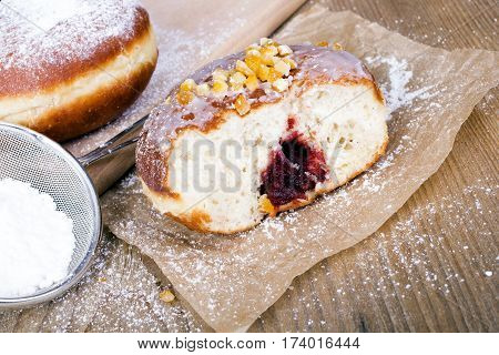 bitten donut on a wooden table, copy space