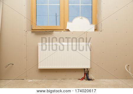 Radiator heating in the room without finishing during construction.