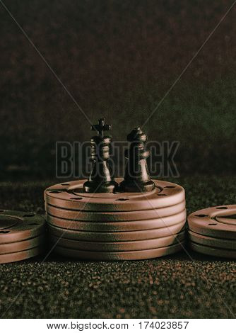 chess and poker chips on a background of the tissue it is the popular items in the world of board games such games develop logical thinking and brighten up leisure