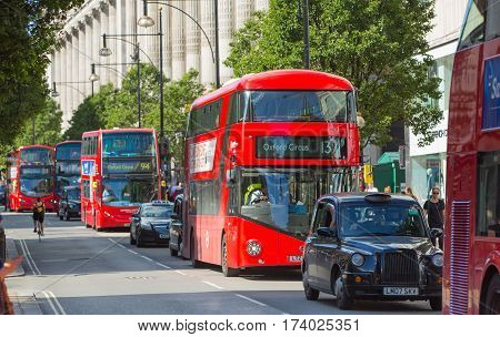 London, UK - 8 September, 2016: Red British double decker buses and taxis in Oxford street, the main destination for shopping in West End London. Modern life and transport concept