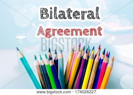 Bilateral agreement, text message on blue background with color pencil