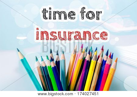 Time for insurance, text message on blue background with color pencil