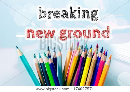 Breaking new ground, text message on blue background with color pencil